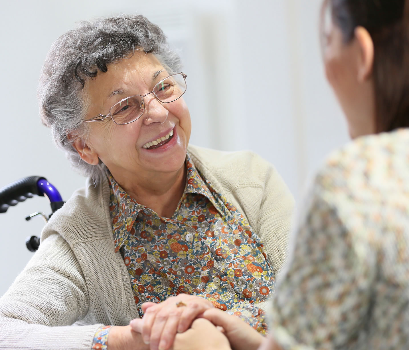 Smiling elderly lady at day care